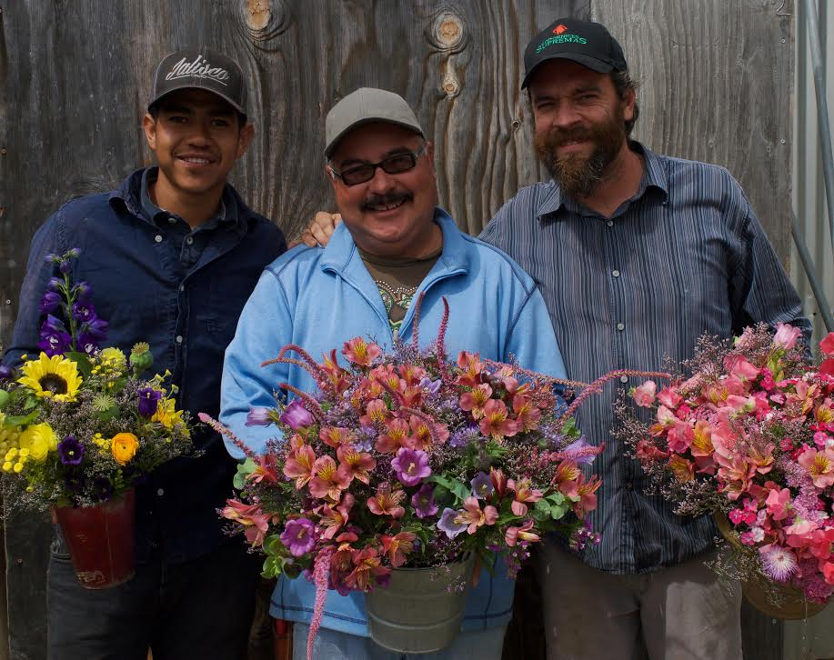 Julio, Carlos and Ben with their market bouquets photo by Lindsey Mizock